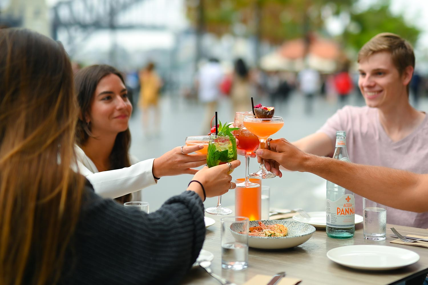 Group of happy and smiling young people with cocktails at Searock Grill